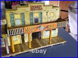 Marx 1950's tin Dodge City litho with 2 figures